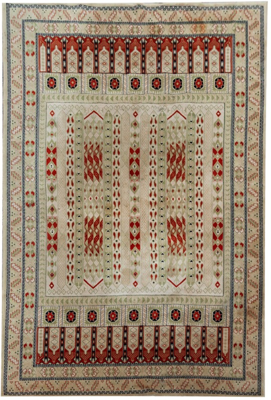 A woolen rug with geometric motifs set on beige field