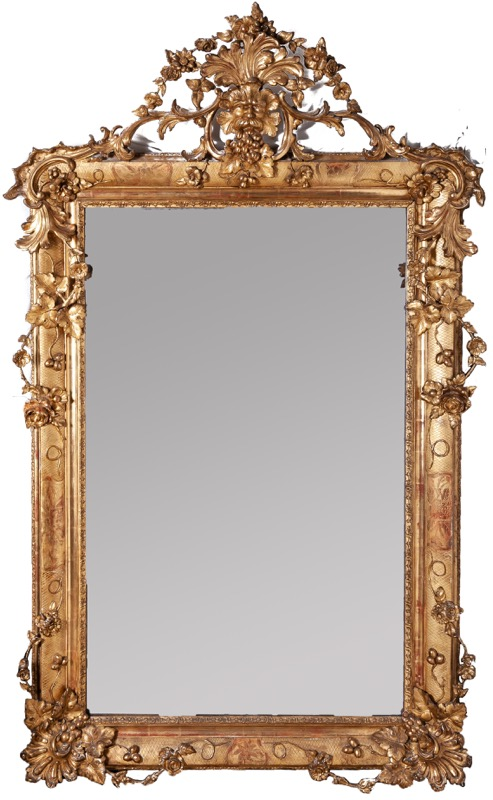 A Spanish carved giltwood mirror with floral motifs, 19th Century