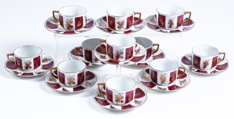A French parcel-gilt porcelain coffee set. Eleven cups with saucers