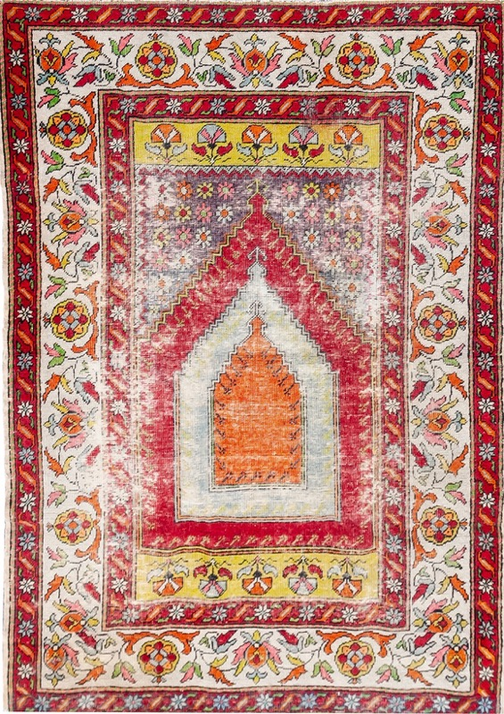 A Turkish praying rug with stylized floral motif. Minor damages