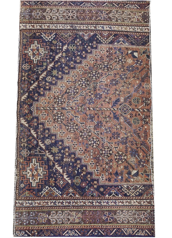 A Caucasian rug fragment with abstract floral motifs