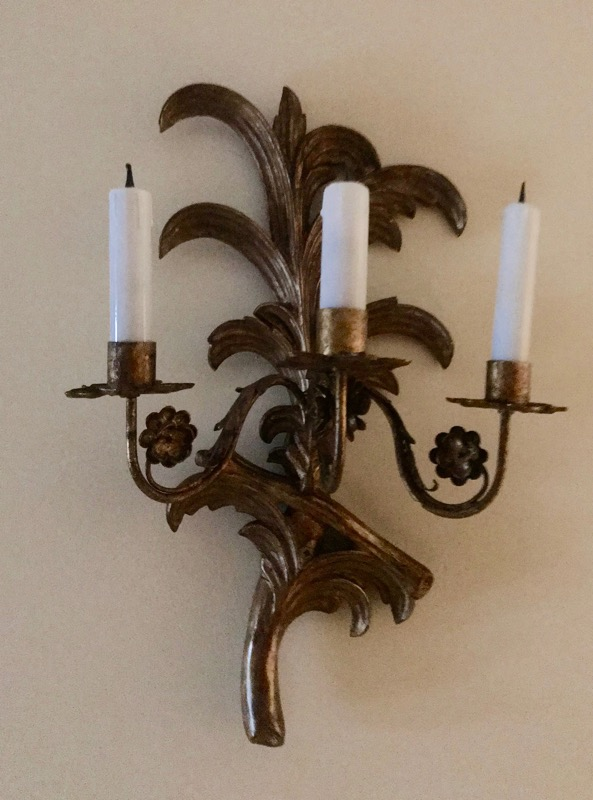 A leaf-shaped bronze three-light wall sconce