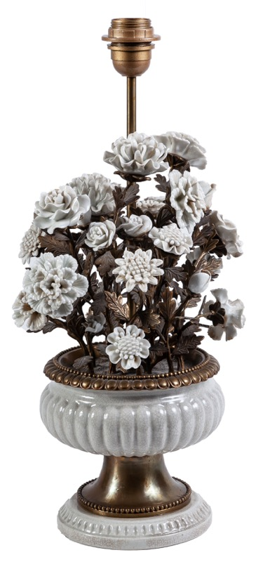 A floral-decorated white porcelain and bronze table lamp
