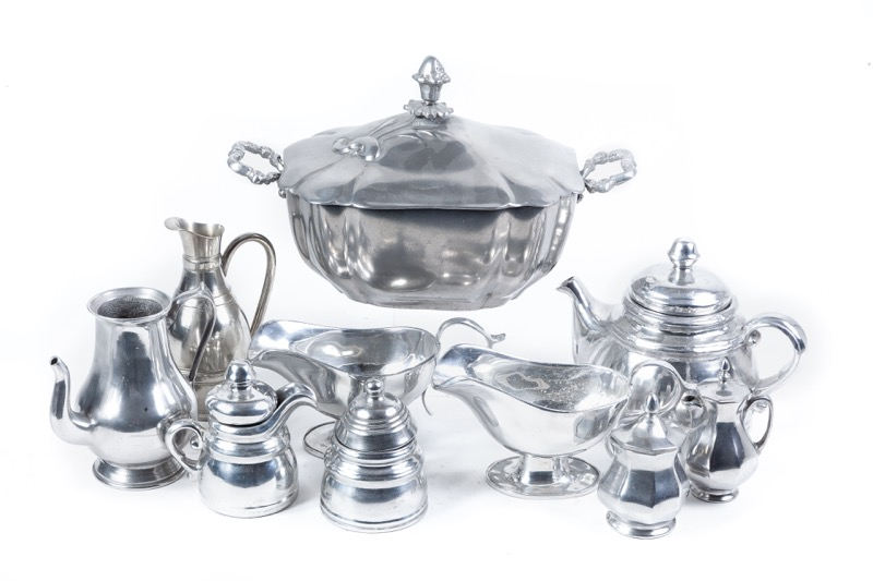 A set of pewter pieces of dinner service