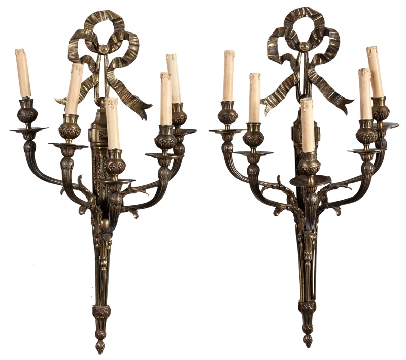 A pair of Louis XV style bronze wall sconces