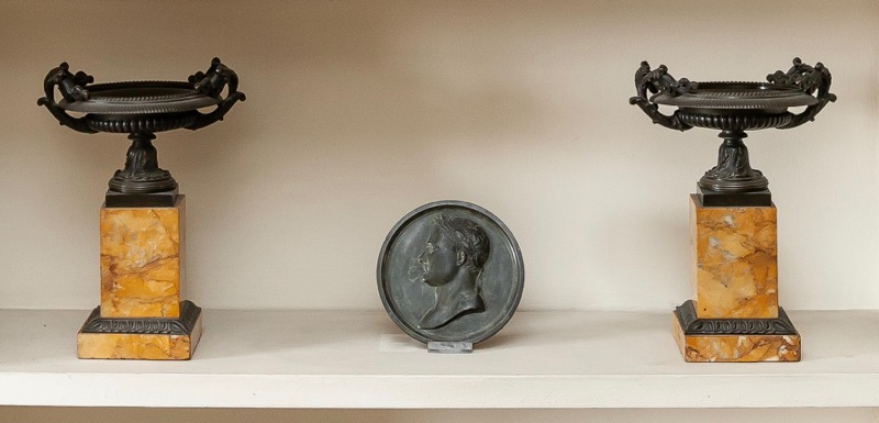 A pair of French patinated bronze kylix on marble bases, 19th Century