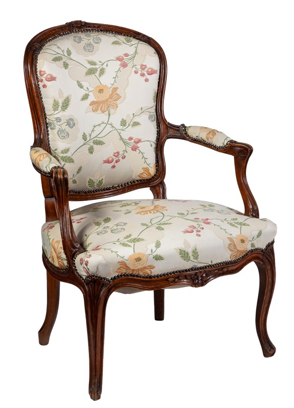 A French Louis XV style carved beech armchair