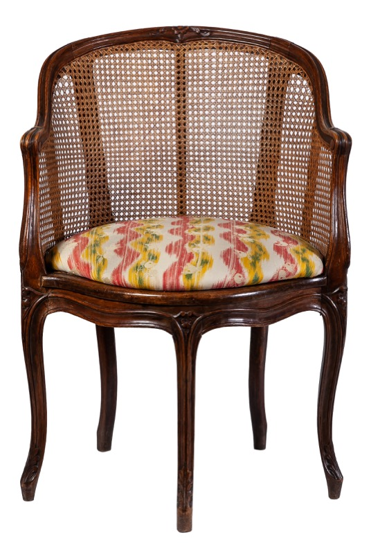 A French Louis XV style carved beech and caned armchair