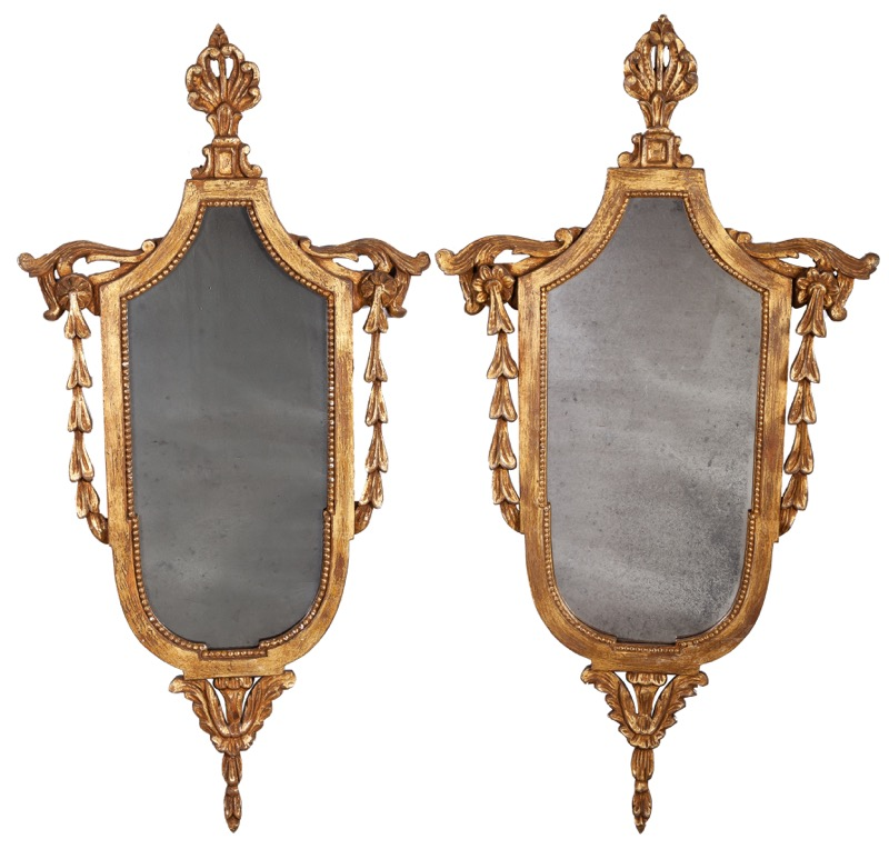 A pair of English carved giltwood mirrors, 20th Century