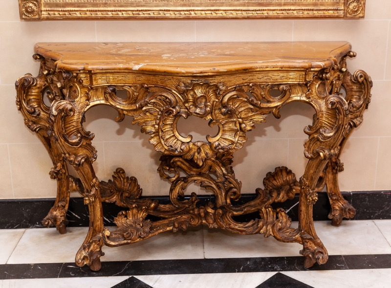 A Spanish carved giltwood marble-top console table, 18th Century