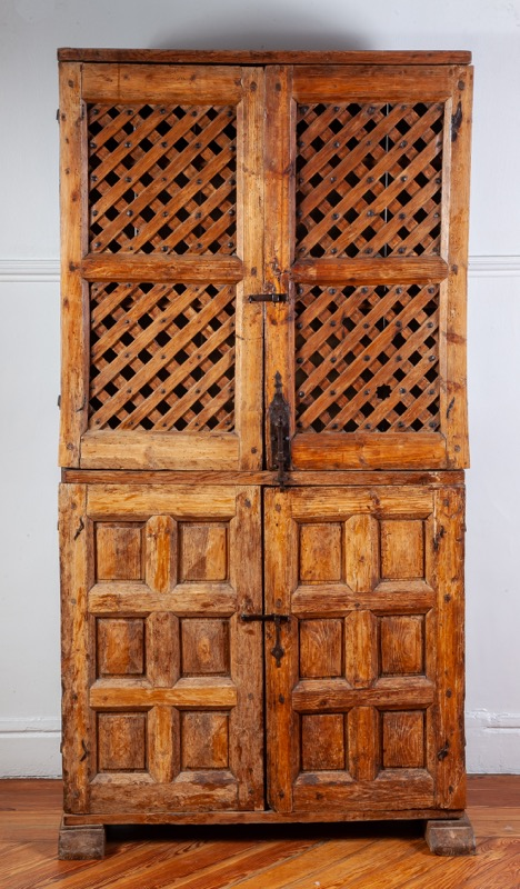 A carved and pierced pinewood armoire, 19th Century