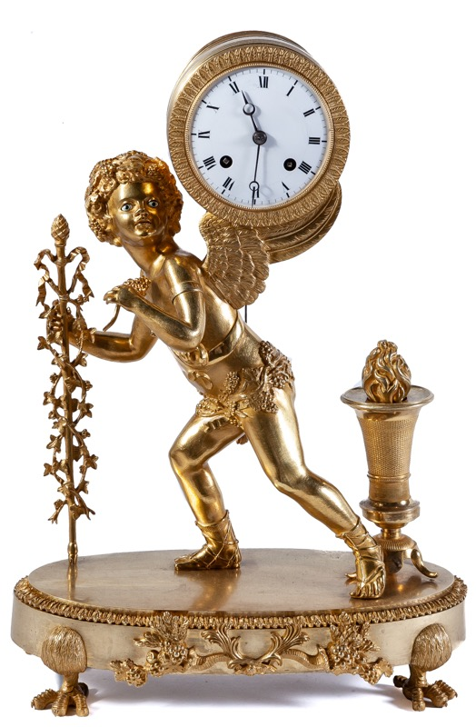 A French Empire gilt bronze mantel clock modelled with the figure of a putto holding an arch-shaped clock